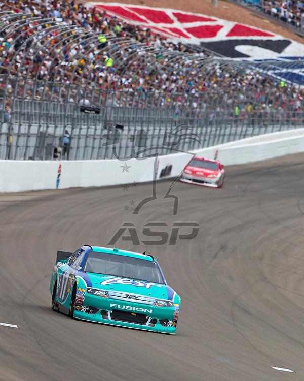 LAS VEGAS, NV - MAR 11, 2012:  Matt Kenseth (17) brings his car through the turns during the Kobalt Tools 400 race at the Las Vegas Motor Speedway in Las Vegas, NV.