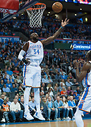 OKLAHOMA CITY, OK - FEBRUARY 26: Oklahoma City Thunder Center Patrick Patterson (54) grabbing a rebound versus Orlando Magic at Chesapeake Energy Arena Oklahoma City, OK (Photo by Torrey Purvey/Icon Sportswire)