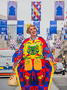 Royal Academician Grayson Perry, with Rose Wylie's street flags in Regents Street, London's West End