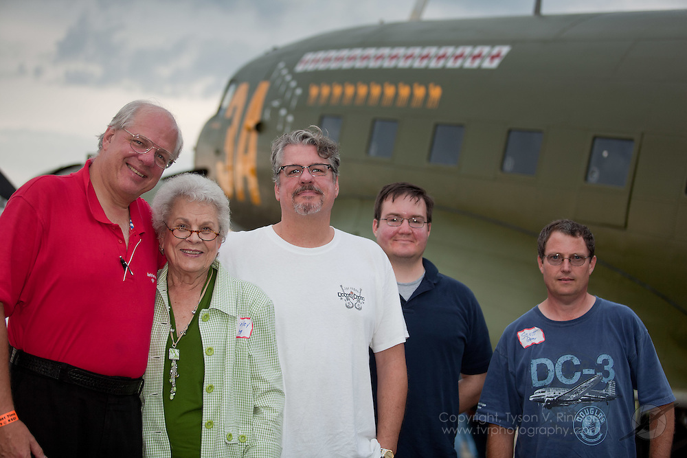 "Standing next to the C-47 aircraft named ""Sky King"" are members of the King family, (L-R) Kevin J. King, Shirley King, Ken King, Jay King, and aircraft owner Scott Glover."