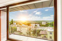 Photo of window view inside apartment with lens flare in background