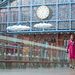 London, UK - 18 April 2013: Nicola Shaw, CEO of High Speed 1 Ltd walks in St Pancras International station on the day a new piece of public art, Cloud: Meteoros by Lucy Orta, is unveiled above the Grand Terrace.