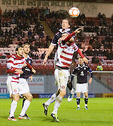 Dundee's Gary irvine outjumps Hamilton Academical's Matthew Paterson - Hamilton Academical v Dundee - IRN BRU Scottish Football League First Division - at New Douglas Park. .- © David Young -.5 Foundry Place - .Monifieth - .Angus - .DD5 4BB - .Tel: 07765 252616 - .email: davidyoungphoto@gmail.com - .http://www.davidyoungphoto.co.uk