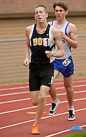 Jonathan Vinnenberg of Bow competes in the 1600 meter during NHIAA Division III Track State Championships at Newfound High School Saturday.  (Karen Bobotas/for the Concord Monitor)
