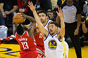 Golden State Warriors guard Klay Thompson (11) defends Houston Rockets guard James Harden (13) at Oracle Arena in Oakland, Calif., on October 17, 2017. (Stan Olszewski/Special to S.F. Examiner)