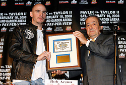 December 11, 2007; New York, NY, USA;  Unbeaten World Middleweight Champion Kelly Pavlik (l) is awarded a plaque for being named the WBO's Fighter of the Year, by Bob Arum (r), at the press conference announcing his rematch against former champion Jermain Taylor, which will take place Saturday, February 16, 2008, at MGM Grand in Las Vegas, NV.  Taylor missed attending the press conference due to the birth of his baby girl on Monday evening.