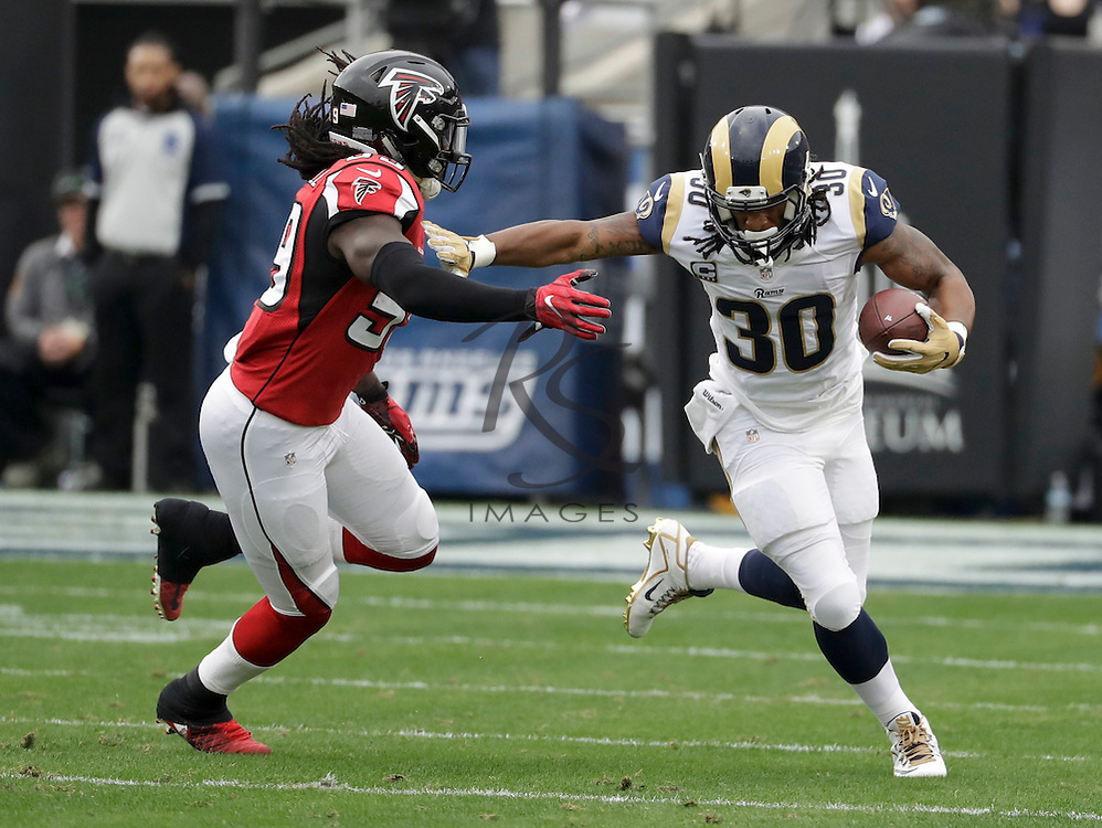 Los Angeles Rams running back Todd Gurley, right, pushes away Atlanta Falcons outside linebacker De'Vondre Campbell during the first half of an NFL football game Sunday, Dec. 11, 2016, in Los Angeles. (AP Photo/Rick Scuteri)