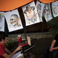 "Caricatures are drawn at the Amish Experience, an immersive tourist destination, in Bird in Hand, PA on August 9, 2014.  Lebanon Levi, the main character of reality television show ""Amish Mafia,"" is pictured in the center of example drawings.  A bevy of Amish themed reality television shows (Amish Mafia, Breaking Amish, Return to Amish and Amish Haunting - to be televised soon) have prompted controversy over the negative portrayal.  One woman, a Mary Haverstick, a film maker, has launched a website in support of the Amish (respectamish.org) and has garnered the support of 3,000 businesses.  Her motivation to start the website was to ""end the bigoted programming.""  REUTERS/Mark Makela (UNITED STATES)"
