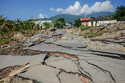 October 3, 2018 - Palu, Central Sulawesi, Indonesia - The road leading to Balaroa village seen destroyed after the earthquake in Palu..A deadly earthquake measuring 7.7 magnitude and the tsunami wave caused by it has destroyed the city of Palu and much of the area in Central Sulawesi. According to the officials, death toll from devastating quake and tsunami rises to 1,347, around 800 people in hospitals are seriously injured and some 62,000 people have been displaced in 24 camps around the region. (Credit Image: © Hariandi Hafid/SOPA Images via ZUMA Wire)