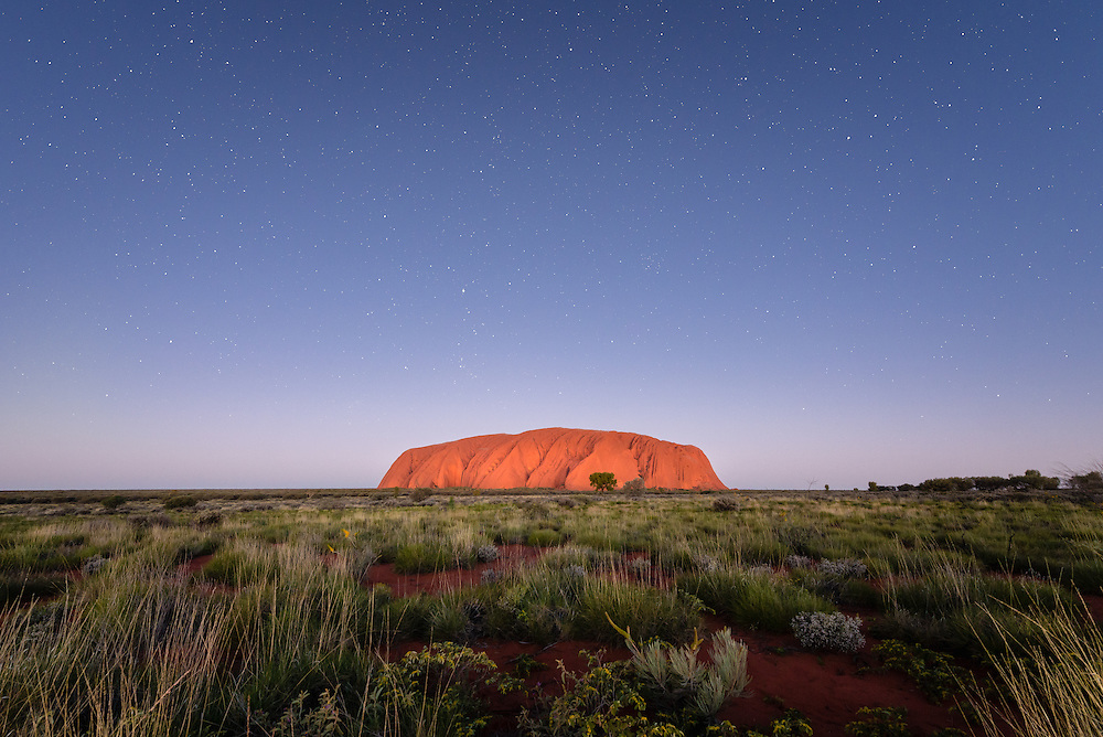 Uluru under night sky with stars