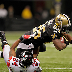 2009 November 02:  New Orleans Saints running back Reggie Bush (25) is tackled by Atlanta Falcons cornerback Tye Hill (24) during the first quarter at the Louisiana Superdome in New Orleans, Louisiana.