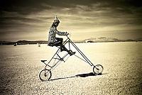 Hunter on a custom bicycle at Burning Man Festival.