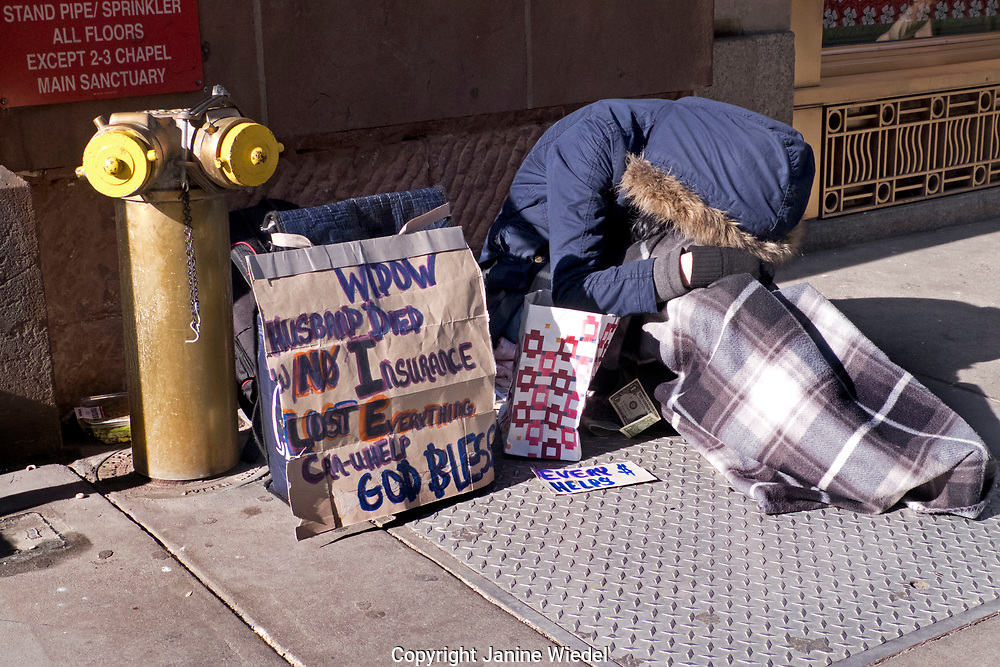 Homeless person begging on streets of Manhattan New York City USA