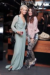 Left to right, KALITA AL SWAIDI and GRACE WOODWARD at a party hosted by InStyle to celebrate the iconic glamour of Dolce & Gabbana held at D&G, 6 Old Bond Street, London on 3rd November 2010.