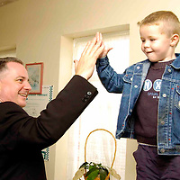 First Minister Jack McConnell and Labour Candidate Charlie Gordon meet visitors at the Castlemilk Pensioners Action Group, 59 Dougrie Drive, Castlemilk...Ben Murray (4) grandson of the centre manager, Margaret Urqhuart recieves a high five as Jack leaves the centre.