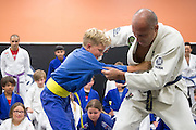 Royce Gracie and Wyatt Gouger during a jiu-jitsu lesson at US Blackbelt Academy on Thursday, March 26, 2015 in Laguna Niguel, Calif. (Photo/Josh Barber)