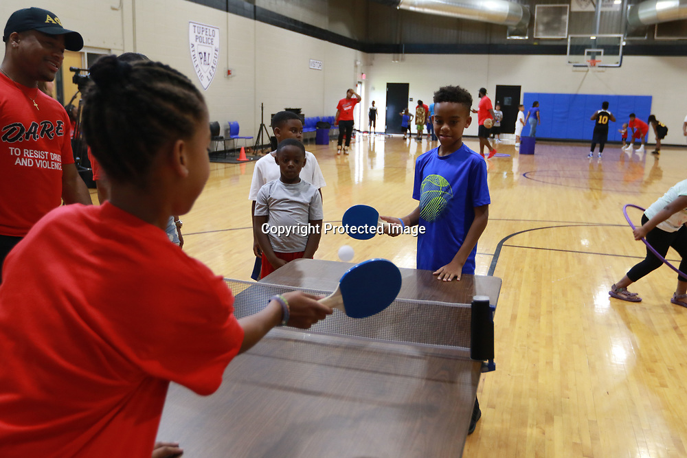 LIBBY EZELL | BUY AT PHOTOS.DJOURNAL.COM<br /> Amyah Hill, left 12, plays Nehemiah Flemmings, 11, in a game of ping pong Saturday at the Police and Kids fun day at the PAL building