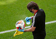 The match balls are disinfected during the Premier League match at Vicarage Road, Watford. Picture date: 20th June 2020. Picture credit should read: Darren Staples/Sportimage