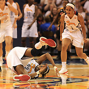 Allison Hightower, Connecticut Sun is fouled while landing a three point basket as team mate Sydney Carter reacts during the Connecticut Sun V Tulsa Shock WNBA regular game at Mohegan Sun Arena, Uncasville, Connecticut, USA. 2nd July 2013. Photo Tim Clayton