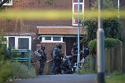 © Licensed to London News Pictures . 26/07/2017 . Oldham , UK . Armed police sneak round the side and to the front of the house and blow through the front door to end the siege in the early hours of the morning . Scene of an armed siege that began at 3.15am on Tuesday 25th July in a house on Pemberton Way in Shaw , is ongoing in to a second night . A man named locally as Marc Schofield is reported to be holding a woman hostage after earlier releasing two children . The gas supply in the area has been cut off and several neighbouring properties have been evacuated . Photo credit : Joel Goodman/LNP