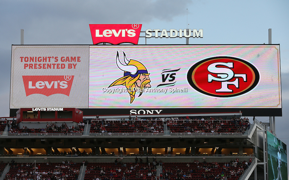 The logos of the competing teams appear on the stadium scoreboard before the San Francisco 49ers 2015 NFL week 1 regular season football game against the Minnesota Vikings on Monday, Sept. 14, 2015 in Santa Clara, Calif. The 49ers won the game 20-3. (©Paul Anthony Spinelli)