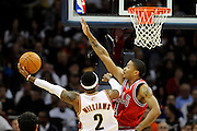 Apr 27, 2010; Cleveland, OH, USA; Cleveland Cavaliers guard Mo Williams (2) drives to the basket against Chicago Bulls guard Derrick Rose (1) during the third period in game five in the first round of the 2010 NBA playoffs at Quicken Loans Arena.  Mandatory Credit: Jason Miller-US PRESSWIRE