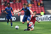 Markus Henriksen (22) of Hull City is tackled by Marlon Pack (21) of Bristol City during the EFL Sky Bet Championship match between Bristol City and Hull City at Ashton Gate, Bristol, England on 21 April 2018. Picture by Graham Hunt.