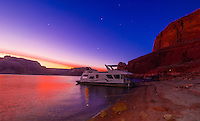 A 75 foot luxury-class houseboat anchored along Lake Powell at twilight, Glen Canyon National Recreation Area, Arizona/Utah border USA