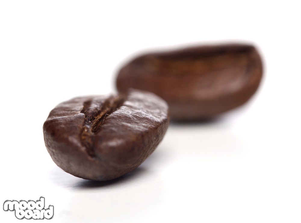 Close-up of coffee grains on white background