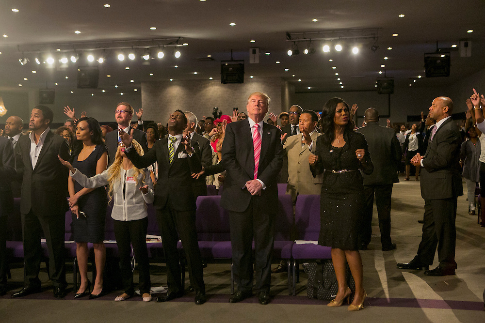DETROIT, MI - SEPTEMBER 3, 2016: Republican presidential nominee Donald J. Trump attends a service at the Great Faith Ministries International church alongside his advisor Omarosa Manigault, his director of African-American outreach, in Detroit, Michigan. CREDIT: Sam Hodgson for The New York Times.