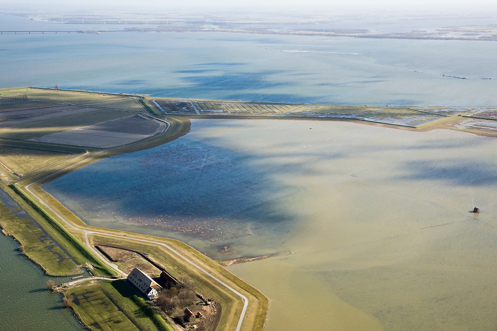 """Nederland, Zuid-Holland, Tiengemeten, 04-03-2008; eilandje in het Haringvliet, oorspronkelijk eigendom - binnen de dijken - van AMEV (Fortis Investments),en Natuurmonumenten (buitendijkse slikken); het eiland werd gebruikt voor de akkerbouw maar is inmiddels 'teruggegeven aan de natuur' (dijken deels doorgestoken) , de laatste boer is in 2006 vertrokken; huidig gebruik onder andere zorgboerderij en kan er gekampeerd worden; nieuwe natuur, onderdeel van de Ecologische Hoofdstructuur; natuurontwikkelingsgebied, natuurontwikkeling natuurontwikkeling; tiengemeenten; the island Tiengemeten in the Haringvliet, originally owned - within the dikes - by AMEV (Fortis Investments), and Natuurmonumenten (Society for conservation of nature); island was used for agriculture but has now """"been given back to nature"""", large parts have been flooded; the last farmer left in 2006; current use, among other, care farms and camping; part of the National Ecological Network;     luchtfoto (toeslag); aerial photo (additional fee required); .foto Siebe Swart / photo Siebe Swart"""