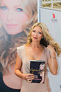 Caprice promotes her autobiography My Boys, My Body, My Business, due out in July. London Book Fair, Olympia, London, UK, 15 Apr 2015.