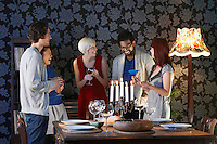 Group of people laughing standing by dining table
