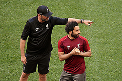 MADRID, SPAIN - Friday, May 31, 2019: Liverpool's manager Jürgen Klopp and Mohamed Salah during a training session ahead of the UEFA Champions League Final match between Tottenham Hotspur FC and Liverpool FC at the Estadio Metropolitano. (Pic by Handout/UEFA)