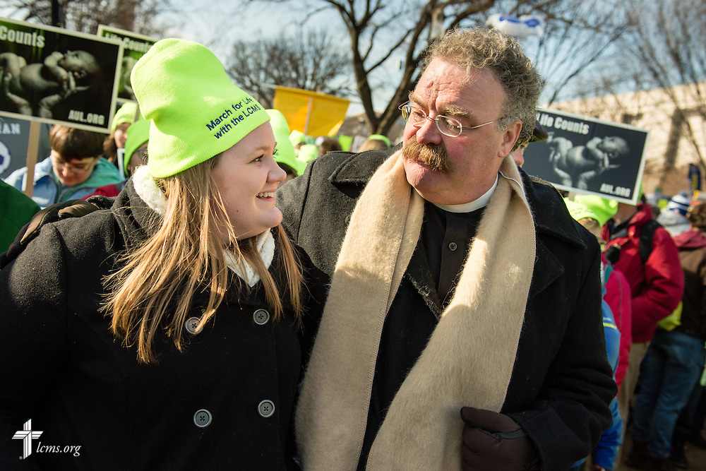 The Rev. Dr. Matthew C. Harrison, president of The Lutheran Church–Missouri Synod, walks with Sarah Crawford of Houston, Texas, during the  2015 March for Life on Thursday, Jan. 22, 2015, in Washington, D.C. LCMS Communications/Erik M. Lunsford