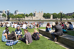 © Licensed to London News Pictures. 26/05/2017. LONDON, UK.  Office workers and tourists enjoy the sunshine on the south bank near the Tower of London at lunchtime. The capital has experienced another day of hot and sunny weather. Photo credit: Vickie Flores/LNP