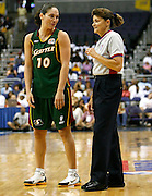 Seattle Storm guard Sue Bird shares a laugh with referee June Courteau  during this WNBA game between the Mystics and the Storm at the Verizon Center in Washington, DC. The Storm won 73-71.  July 23, 2006  (Photo by Mark W. Sutton)