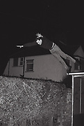 Male hedge jumping, Southall, UK, 1986.