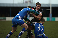 Alec Susino (R) of Barrow Raiders tackles Jake Emmitt (C) of Toronto Wolfpack during the Betfred Championship match at Craven Park, Barrow-in-Furness<br /> Picture by Stephen Gaunt/Focus Images Ltd +447904 833202<br /> 11/02/2018