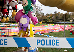 © Licensed to London News Pictures. 04/11/2018. Woking, UK. A fairground stall full of children's toys remains behind a cordon next to a deflated slide in Woking Park after it collapsed injuring eight children. The park was holding a fireworks party when the accident happened. Photo credit: Peter Macdiarmid/LNP
