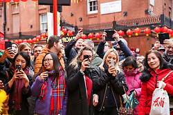 © Licensed to London News Pictures. 25/01/2020. London, UK. Chinese and non-Chinese community celebrates Chinese New Year, the Year of the Rat in London's China Town. Photo credit: Dinendra Haria/LNP