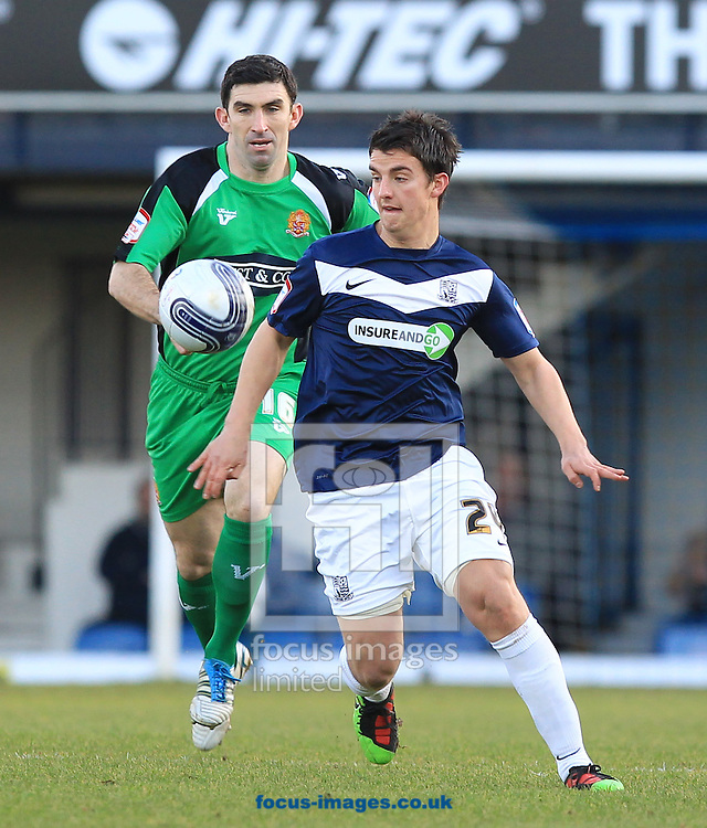 Picture by John Rainford/Focus Images Ltd. 07506 538356.02/01/12.Elliot Benyon of Southend and Kevin Maher of Dagenham & Redbridge during the Npower League 2 match at Roots Hall stadium, Southend.