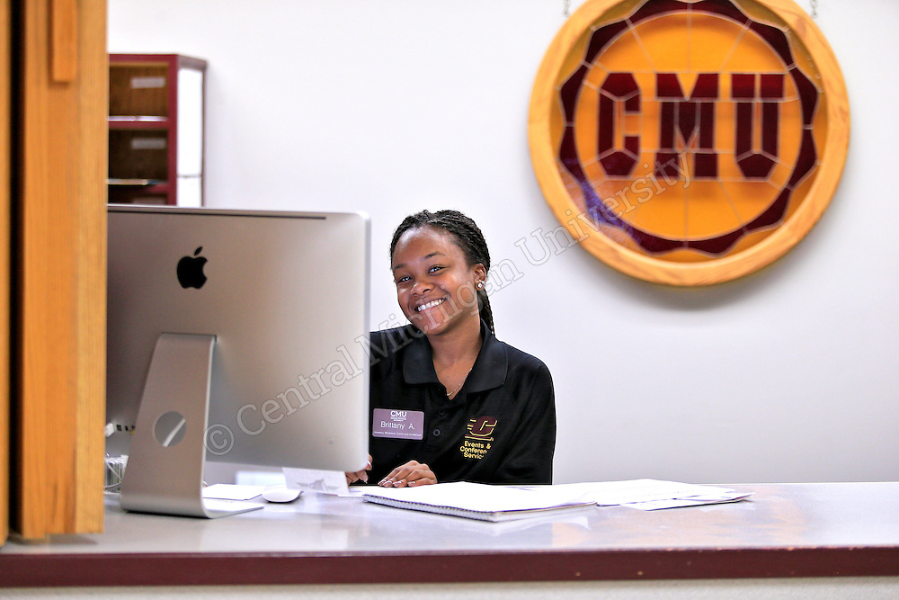 Brittany Allen, Detroit sophomore, BCA major working at the information desk at the UC. Photo by Steve Jessmore/Central Michigan University