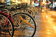Bikes lined up on a street in Japan.