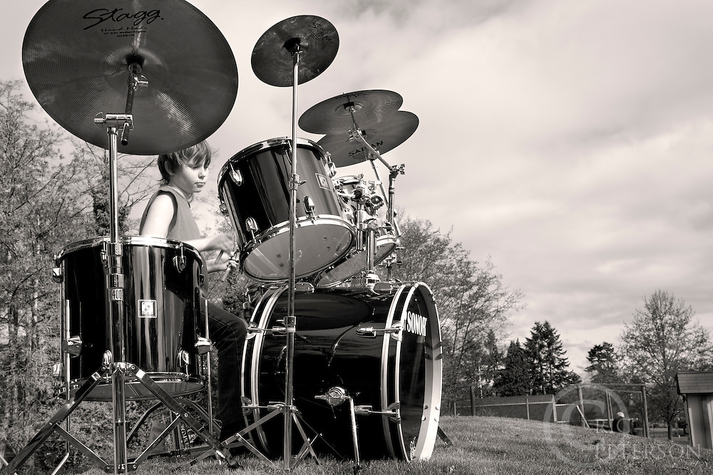 youg man on playing drum kit outdoors