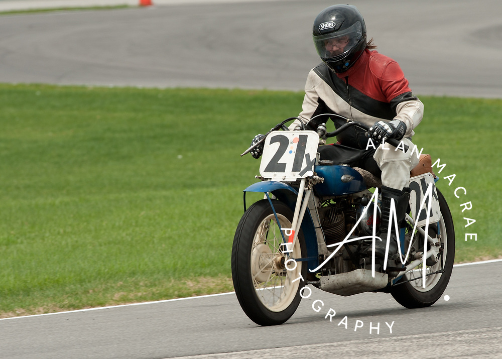 Karl Myers of Port Clinton, Pennsylvania rides his 1939 Indian motorcycle around the track during the US Vintage Motorcyce Grand Prix at New Hampshire Motor Speedway on Monday, June, 14, 2010.  Myers, who is a Master BMW motorcycle technician, traveled to NHMS with his dad, Stan, who is 86 and has been racing motorcycles since 1946.  (Alan MacRae/for the Citizen)
