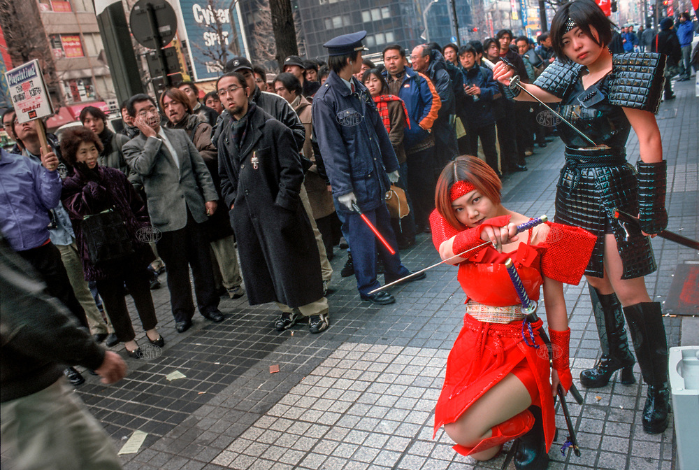 ©Tom Wagner 2004<br /> Akihabara area. 2 characters from playstation 2 games outside laox store<br /> japan industry electronics