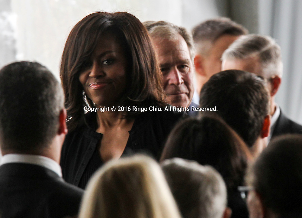 First Lady Michelle Obama and Former president George W. Bush leave the funeral service for the former first lady Nancy Reagan at the Ronald Reagan Presidential Library and Museum in Simi Valley, California on March 11, 2016. Reagan died of congestive heart failure in her sleep at her Bel Air home Sunday at age 94. A bout 1,000 guests from the world of politics attended the final farewell to Nancy Reagan as the former first lady is eulogized and laid to rest next to her husband at his presidential library.<br />    (Photo by Ringo Chiu/PHOTOFORMULA.com)<br /> <br /> Usage Notes: This content is intended for editorial use only. For other uses, additional clearances may be required.