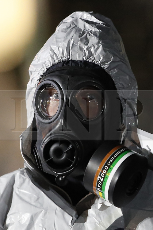 © Licensed to London News Pictures. 07/03/2018. Salisbury, UK. Police in protective suits and gas masks appear to be rehearsing search techniques near Salisbury. Former Russian spy Sergei Skripal and his daughter were taken ill following a suspected poisoning in the city. The couple where found unconscious on bench in Salisbury shopping centre. Authorities now suspect a chemical nerve agent was used. Photo credit: Peter Macdiarmid/LNP