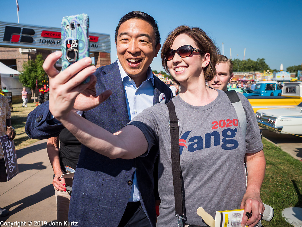 09 AUGUST 2019 - DES MOINES, IOWA: ANDREW YANG poses for a selfie while he walked through Iowa State Fair Friday. Yang, an entrepreneur, is running for the Democratic nomination for the US Presidency in 2020. He spoke at the Des Moines Register Political Soapbox at the Iowa State Fair Friday. Iowa hosts the the first election event of the presidential election cycle. The Iowa Caucuses will be on Feb. 3, 2020.        PHOTO BY JACK KURTZ